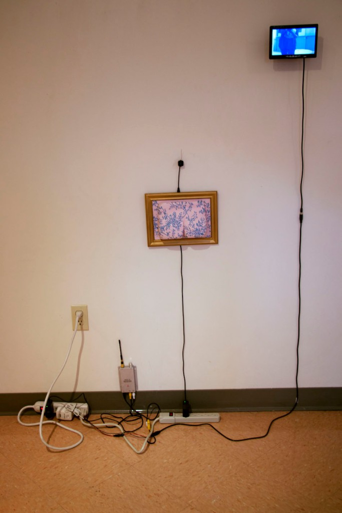 Title:Booty Medium:Acrylic and Goldleaf on Ceramic, Camera, Wires, and surveillance video feed Size:7x5x5